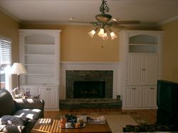 Added Cabinetry to existing fireplace mantel